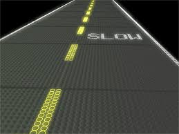 The product behind Solar Roadways are hexagonal Solar panels with LEDs and reinforced with tempered glass. Underneath the glass there are a lot of tiny LED's that are capable of certain configurations like traffic lines, early warning symbols and are pressure sensitive so they light up when something is on the road.