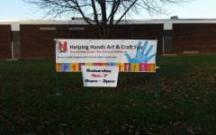 Helping Hands Craft Fair has signs throughout the Neenah Community, including Neenah High School.