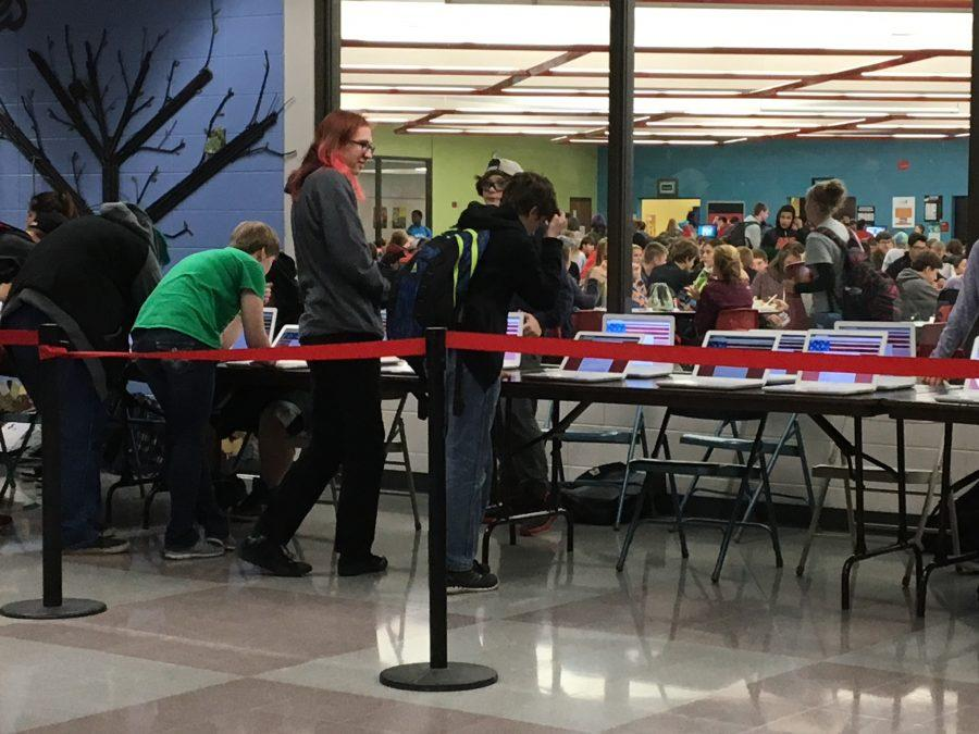 Students take advantage of lunch to cast their ballots.