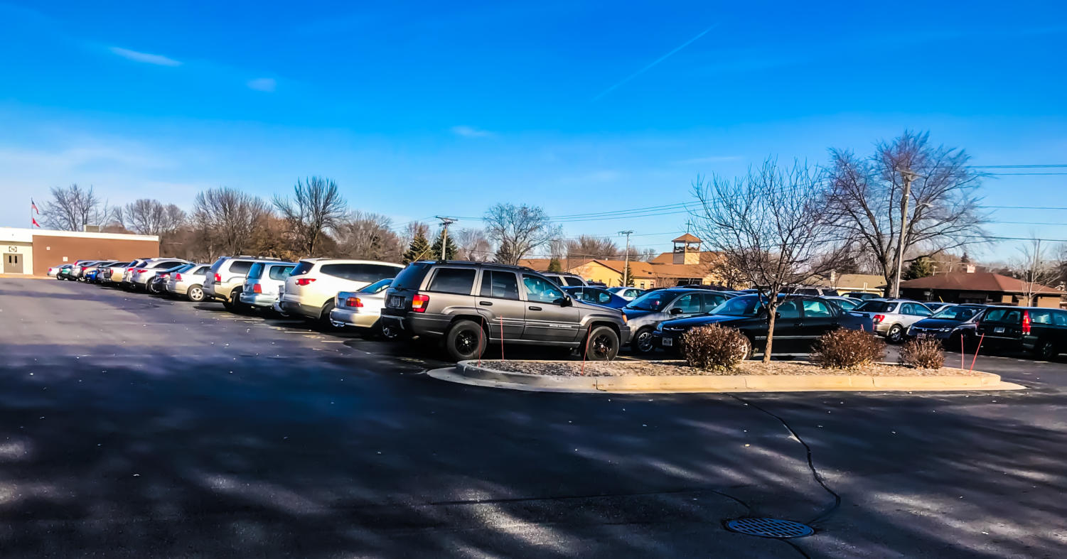 The most noticeable change is that a car drives around the parking lot, issuing tickets instead of Mr. William Bauer, who functions as campus security.