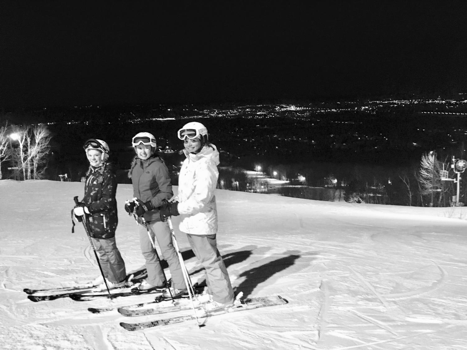 This photograph features senior Savannah Ely (right) on the slopes with family friends only moments before her accident.