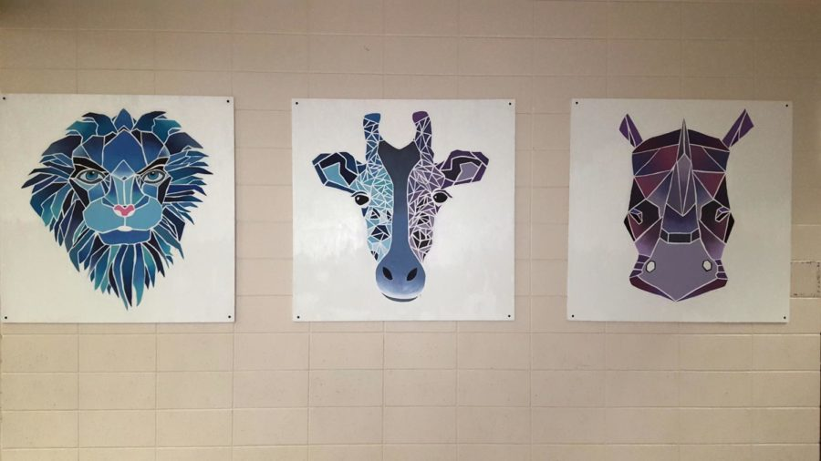Lion%2C+giraffe+and+rhino+canvases%2C+created+by+senior+Jenna+Beyer%2C+greet+students+outside+the+cafeteria.