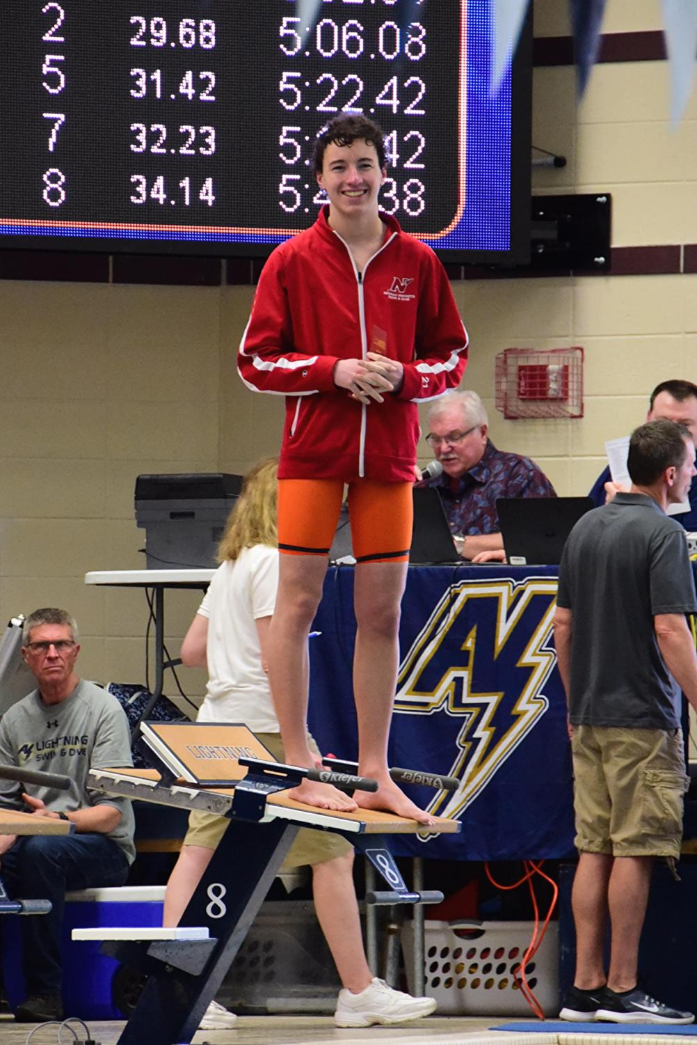 Tony Van Sambeek stands on the block receiving a ribbon for his 8th place finish at the FVA conference meet.