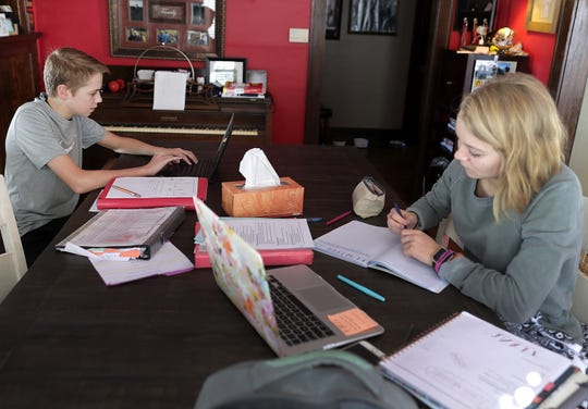 Frankie and Davis Green working on homework at home on a Digital Learning Day - The Post Crescent.