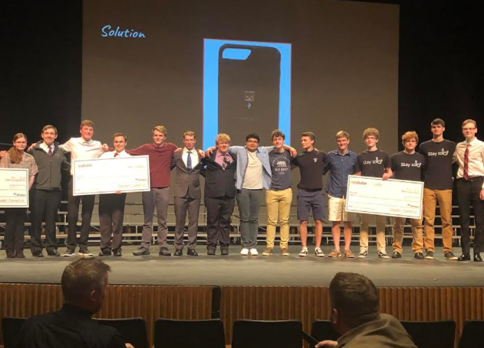 Last year's Incubator students winning cash prizes at Incubator contest