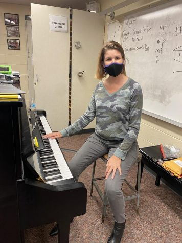 Miss Westcott at her piano in the choir room.